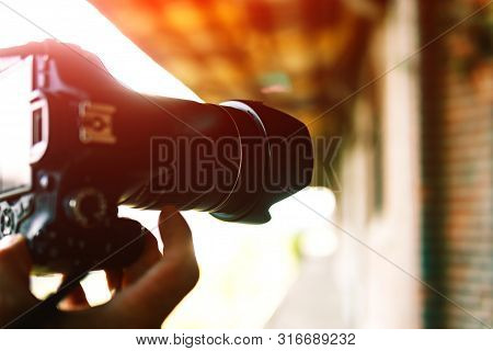 The Camera Is In The Hands Of The Photographer.