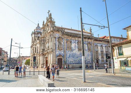 Porto, Portugal - August 31 2018: People On The Street By Famous Igreja Do Carmo And Adjacent Igreja