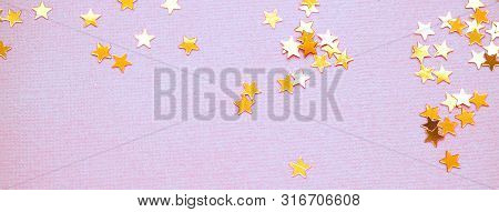 Golden Stars Glitter On Violet Background. Festive Holiday Bright Backdrop. Design For Your Ad, Post