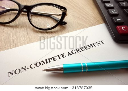Non-compete Agreement Document For Filling And Signing On Desk, Business Competition   Concept