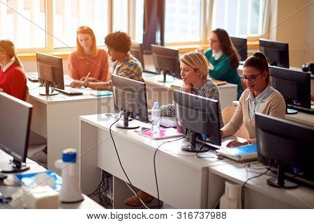 IT workshop at university. Group of Students on class with computer on university