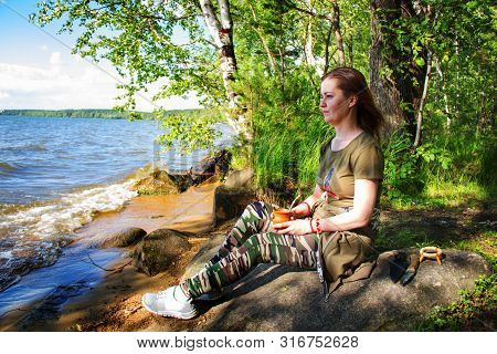 A Woman Is Meditating By The River Emotional Meditating Lifestyle. Introspection Relaxing