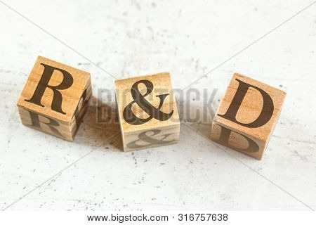 Three Wooden Cubes With Letters R D On White Board.