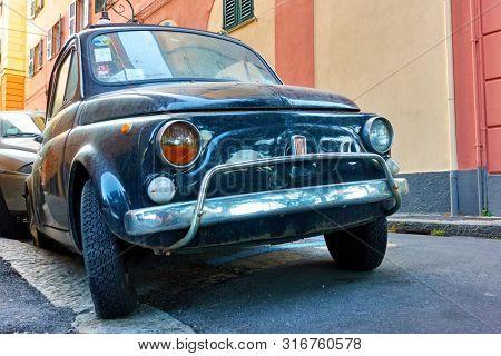 Genoa (Genova), Italy - June 30, 2019:  Classic car Fiat 600 in the old street in Genoa