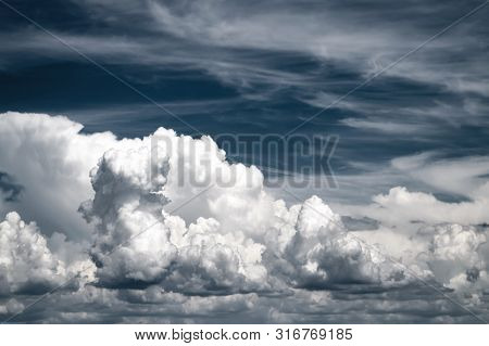 Blue Sky With White And Gray Clouds. Black And White Image.