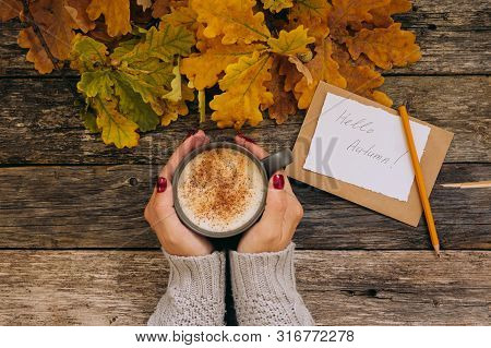 Autumn Composition Still Life. Womans Hands With Cup Of Coffee, Cappuccino, Latter Coffee. Autumn Le