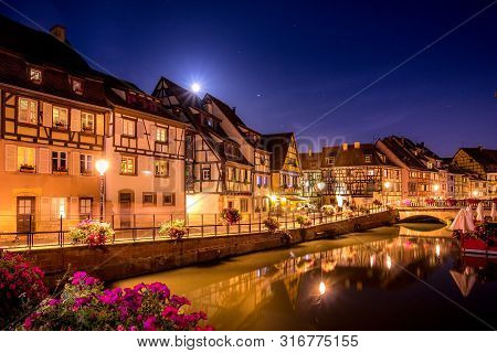 Colorful Nightscape In Colmar, Alsace, France  With Flowers And Lights