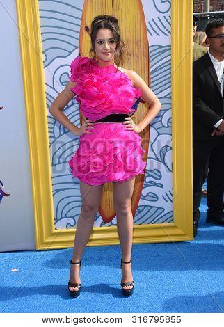 LOS ANGELES - AUG 11:  Laura Marano arrives for the 2019 Teen Choice Awards on August 11, 2019 in Hermosa Beach, CA