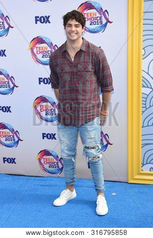 LOS ANGELES - AUG 11:  Noah Centineo arrives for the 2019 Teen Choice Awards on August 11, 2019 in Hermosa Beach, CA