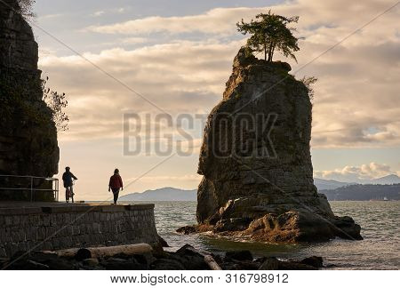 Siwash Rock English Bay Vancouver. English Bay Peaking Around Siwash Rock In Stanley Park. Vancouver