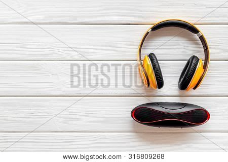 Wireless Speaker And Headphones As Music Gadgets On White Wooden Background Top View Mockup