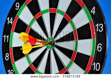 The Target For The Sport Of Darts And The Darts Hit The Target. Darts Game In Which Opponents Throw