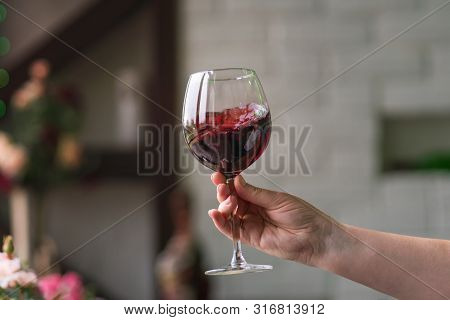 Hand Sommelier Holding Glass Of Red Wine. Swirling Wine Glass In Wine Tastings  Red Wine Concept. Wi