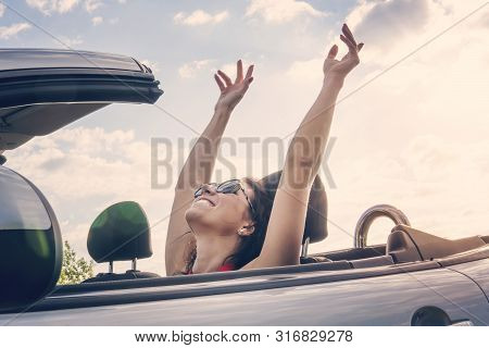 Happy Girl Relaxing Enjoying Sunshine Sitting In Convertible Car On Summer Road Trip Vacation Drivin