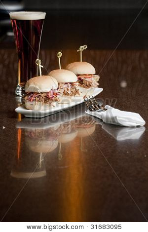 small pulled pork sandwiches in a restaurant