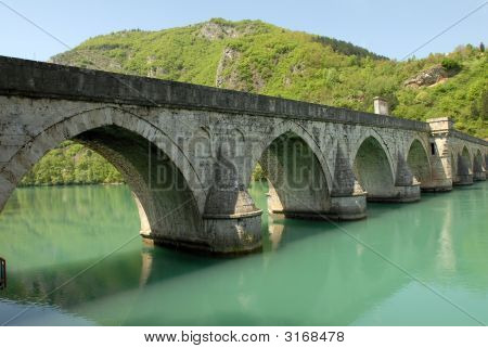 Old stone middle age bridge in Visegrad Bosnia copy space poster
