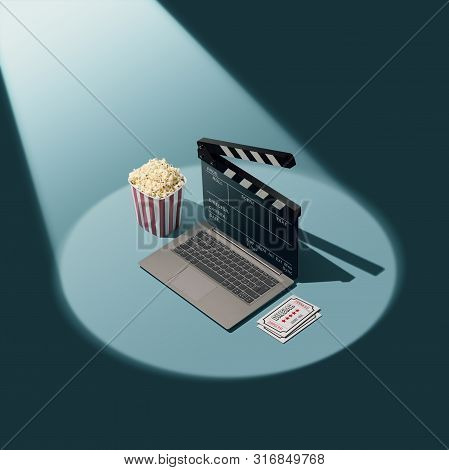 Online Movie Streaming And Cinema: Laptop With Clapperboard As Screen, Popcorn And Tickets In The Sp