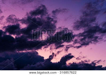 Blue Hour Sky Clouds Background. Beautiful Landscape With Clouds And Purple Sun On Sky