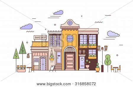 Urban Landscape With Facades Of Exquisite European Building And Bakery. Street View Of City District