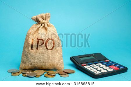 Money Bag With The Word Ipo (initial Public Offering; Stock Market Launch) And A Calculator. The Fir