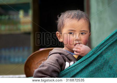 Rumtse, India - August 22, 2015: Portrait Of A Boy Looking Away From Camera Met On The Keylong-leh R