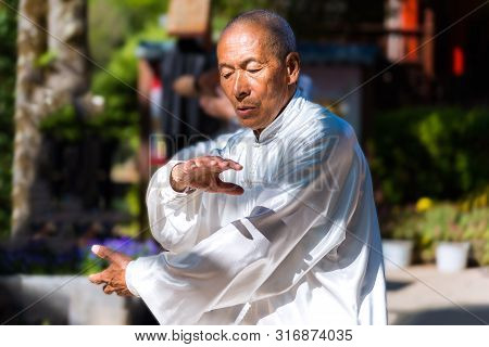Lijiang, China - April 27, 2019: Unidentified Tai Chi Master Exercise With Concentrate Expression. T
