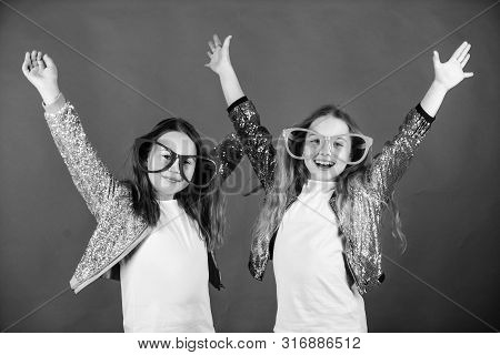 Celebrating Together. Party Girls. Cool Party Girls Wearing Fancy Glasses. Small Kids In Party Goggl