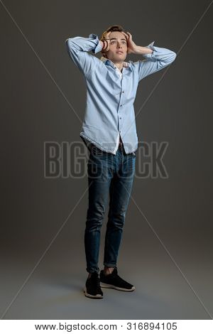 A full length portrait of a young goodlooking guy. Men casual fashion.