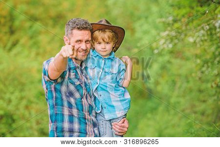 Growing Cute Cowboy. Small Helper In Garden. Little Boy And Father In Nature Background. Spirit Of A