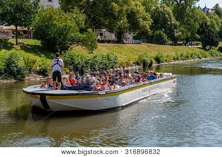 Gothenburg, Sweden - July 17, 2019: Summer View Of A Small Open Sightseeing Canal Boat With People A
