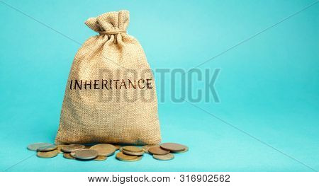 Money Bag With The Word Inheritance. Separation Of Inheritance Between Relatives Or Transfer Of Prop