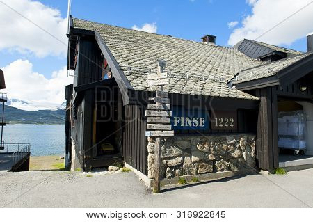 Finse, Norway - July 28, 2019: Signpost In The Front Of Hotel Finse 1222 In Finse