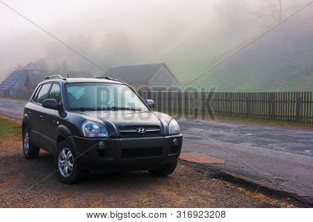 Mizhhirya, Ukraine - Oct 14, 2018: Hyundai Tucson Suv On The Old Cracked Countryside Road Side In Vi