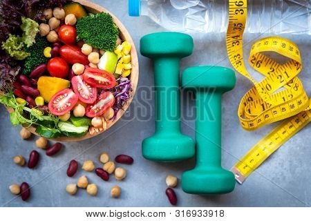 Fresh Vegetable Salad And Healthy Food For Sport Equipment For Women Diet Slimming With Measure Tap