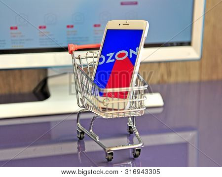 Smartphone With Ozon Logo In Shopping Cart