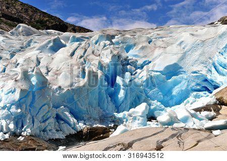 Amazing Close Up View Of Nigardsbreen Glacier