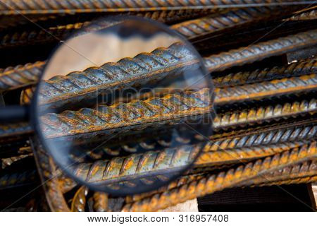 Industrial background through a magnifying glass. Rebar texture. Rusty rebar for concrete pouring. Steel reinforcement bars. Construction rebar steel work reinforcement. Closeup of Steel rebars. poster
