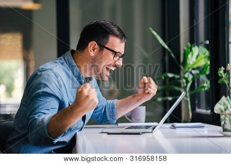 Overwhelmed By Success Young Cheerful Adult Casual Businessman Or Entrepreneur Smiling And Vividly C
