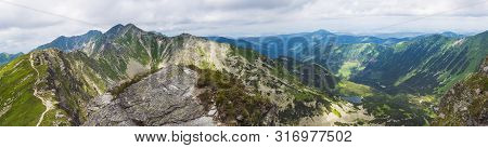 Panoramic View From Placlive Peak On Western Tatra Mountains Or Rohace Panorama. Sharp Green Mountai