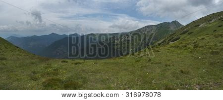 View From Tatra Mountain Trail On Baranec To Western Tatra Mountains Or Rohace Panorama. Grassy Mead