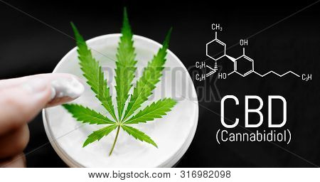 Cannabis Cbd Cream. Top View Of Jar With Cbd Hemp Salve With Cannabis Leaf On Black Background. Mari