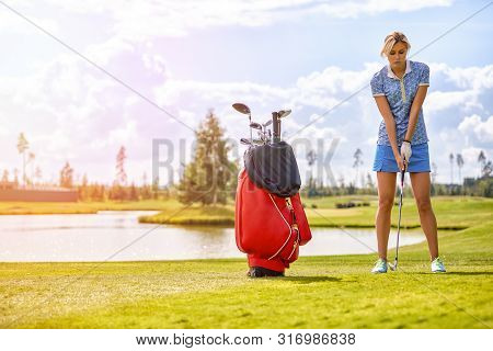Golf Course, A Beautiful Girl Getting Ready To Hit The Ball. Lifestyle Concept, Golf Concept, Pursui