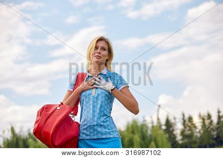 Golf Concept, Copy Space. Women Golf Time Holding Golf Equipment On Green Field Background. The Purs