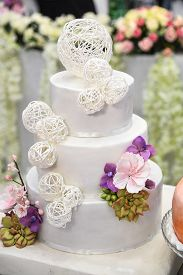 Wedding Cake With White Decorations And Flowers. Wedding Concept