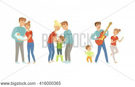 Cheerful Family Couple Nursing And Playing With Kids Set, Parents Upbringing And Caring For Their Ch