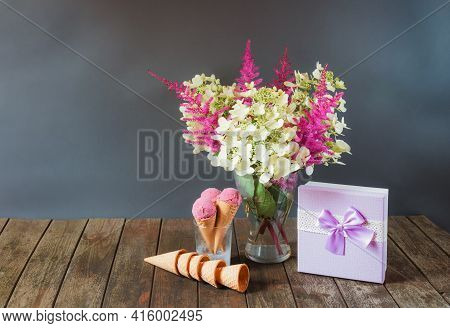 Beautiful Astilbe And Hydrangea Flowers, Purple Gift Box And Cherry Ice Cream On Wooden Table. Selec