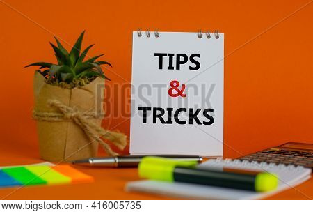 Tips And Tricks Symbol. White Note With Words Tips And Tricks On Beautiful Orange Background, Colore