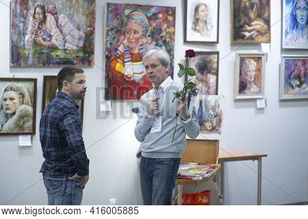 Syktyvkar, Komi,russia, April 6, 2021, Exhibition Of Paintings.people Walk Around The Exhibition And