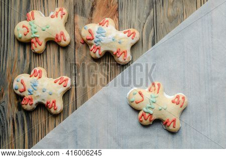 Gingerbread Gingerbread Men On A Wooden Table.