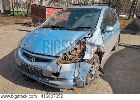 Moscow, Russia - April 04, 2021: Honda Car After A Car Accident Parked On The Street, Headlamp Broke